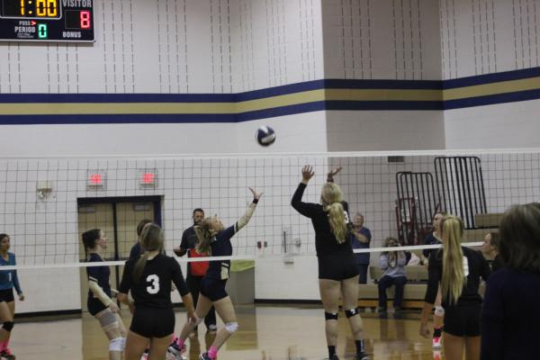 Savannah Burkett taps the ball over for a point at the Lady Pirate's senior night Oct. 29 against Graford. Photo/Trevor M. Wyatt