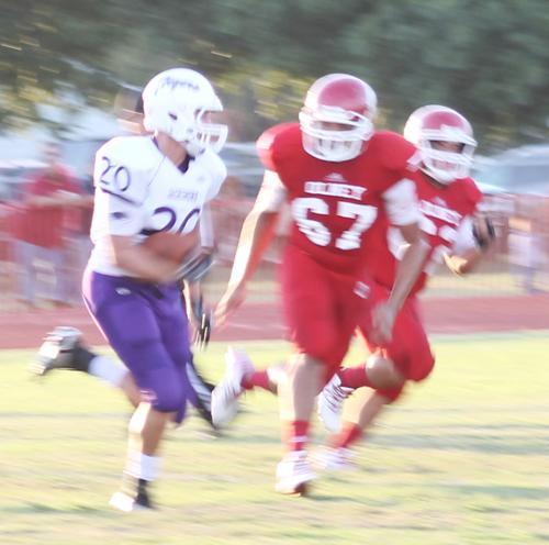 Kade Weldon looks for running room during first quarter action Friday