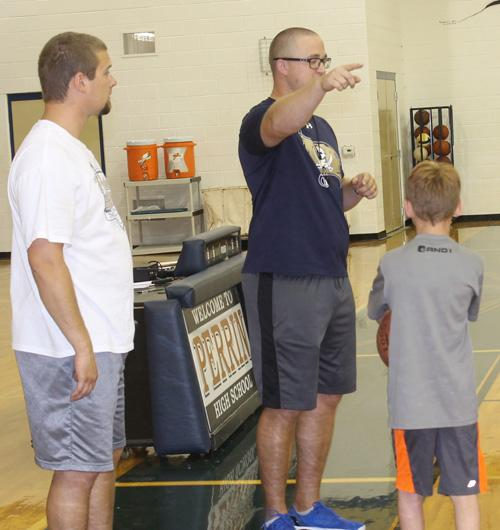 Weston Bond and Mike Drake run basketball camp earlier this week.