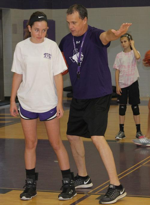 Jacksboro Girls Basketball Coach Todd Matlock works with a camper during basketball volleyball camp Monday morning
