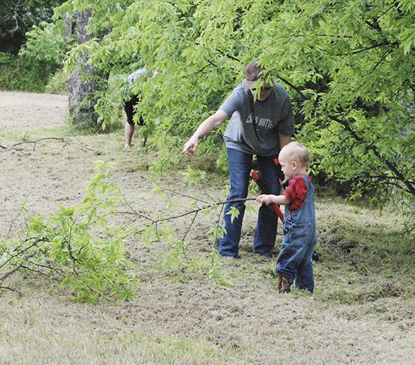 Even some tiny hands joined in to help with the cleanup for the new park Saturday. Courtesy / Terry McDaniel
