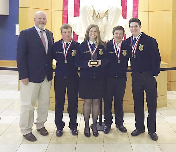 Pictured are the team members, second from left, Tyler Harmonson, Kamlynn Thomas, Tyler Rogers and Hunter Hackley with sponsor, Kevin Thomas.