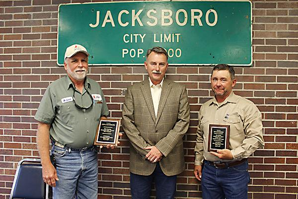 City of Jacksboro Water Supervisor Robert Tomison, City Manager Mike Smith and Mayor Alton Morris display the plaques Jacksboro won in the 2017 Big Country Drinking Water Contest.