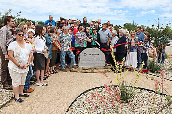 Cutting the ribbon on the Cornerstone Center are the descendants of Jesus Name Church creators Mollie Smith and Dollie Tilghman.