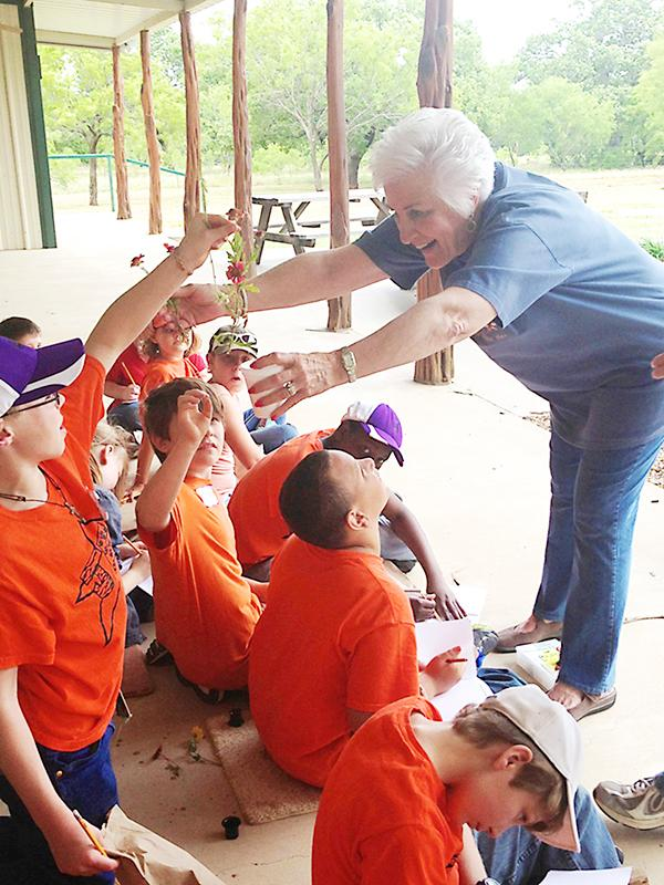 Jacksboro Elementary students learn about different types of foliage with Martha Hackley Salmon during their visit to Richards Ranch as part of the Kids on the Land program. The annual event provides a hands-on learning experience teaching children about the land that sustains them and how to protect it.