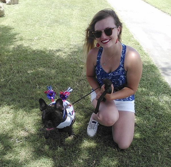 Quigley and owner Caitlin Fudge pose for a photo after Quigley won the My Pet's the Best contest hosted by the Friends of the Jacksboro Animal Shelter during TNT Fest Saturday.