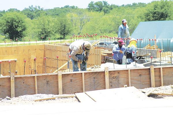 Workers took advantage of the dry weather Wednesday to continue work on the FCH Wellness Center. Recent rains have delayed construction but FCH officials are still hoping for a mid-Fall completion.