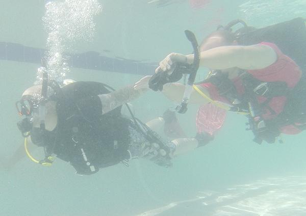 Jacksboro firefighters receive dive training at the city pool Saturday.