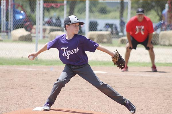 A Jacksboro player gets ready to release a pitch during the TNT Sizzler Youth Baseball Tournament last year.