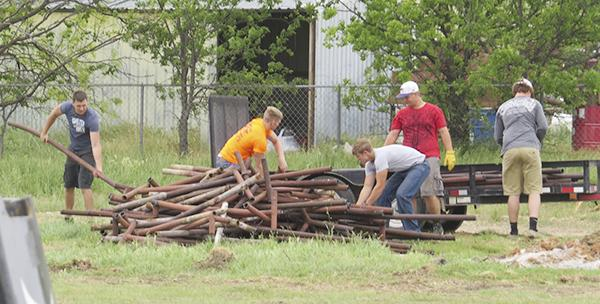 Student volunteers clear pipe from the land around Jesus Name Church which will be home to a nondenominational gathering place for youth and community events.  Courtesy / Star Kinder