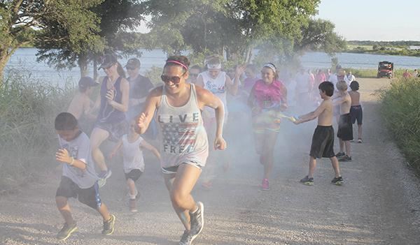 Elizabeth Pardue leads a pack of runners in last year's BREAST 5K Fun Run. Last year's run was a color run. This year's will kick off TNT Fest with late registration at 9 a.m. and include 10 inflatable obstacles along the course with a 25-foot water slide at the finish.