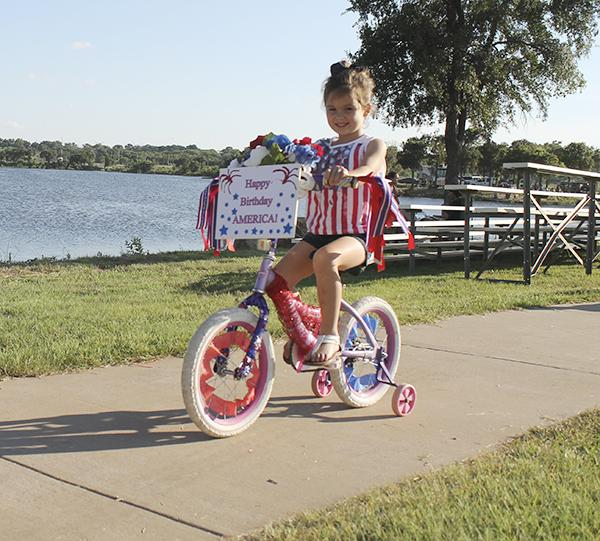 Last year's Red, White and Blue Kids Parade featured many patriotic entries who took a cruise around the playground.