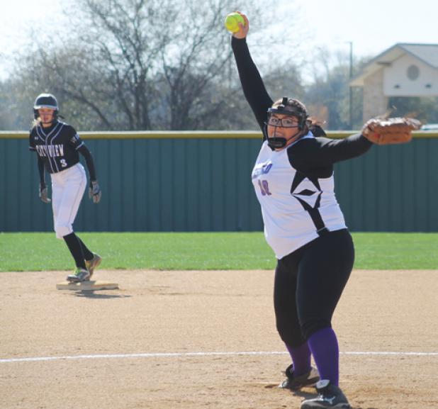 Hanah Drennan lets go of a first inning pitch while City View's Maddie Chalenburg looks on.