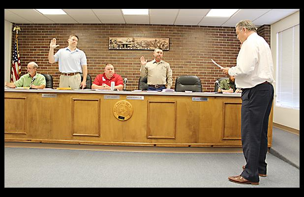 Jacksboro City Attorney David Spiller, right, swears in Place 4 Councilman Joe Mitchell and Mayor Alton Morris. Both were unopposed in the May election.