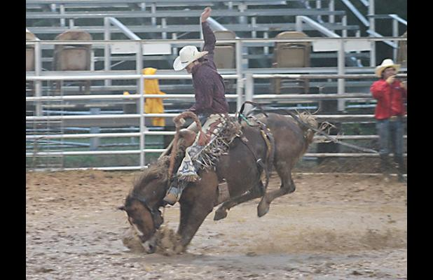 A saddle bronc competitor rides in the mud during last year's Jack County Sheriff's Posse Rodeo.