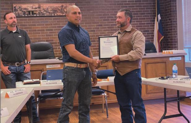 City honors man who saved another in house fire
