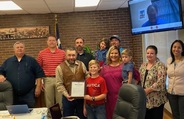 Council honors youth with property saving action