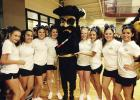Perrin High School varsity cheerleaders and mascot Petey the Pirate pose for a picture while at cheer camp recently.