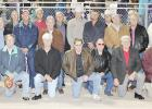 The Jacksboro football players from the 1962 State Championship Team reunited with their coach Chuck Curtis, back center, during the 2012 Homecoming.