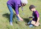 Martha Salmon helps Evan Walker identify a wildflower. Fourth graders spent a portion of the day as junior naturalists — observing, collecting, journaling, drawing and sharing information with classmates on plants they found at Richards Ranch.